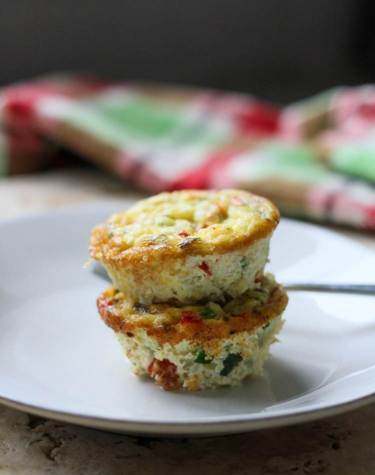 two mediterranean egg muffins stacked on a white plate