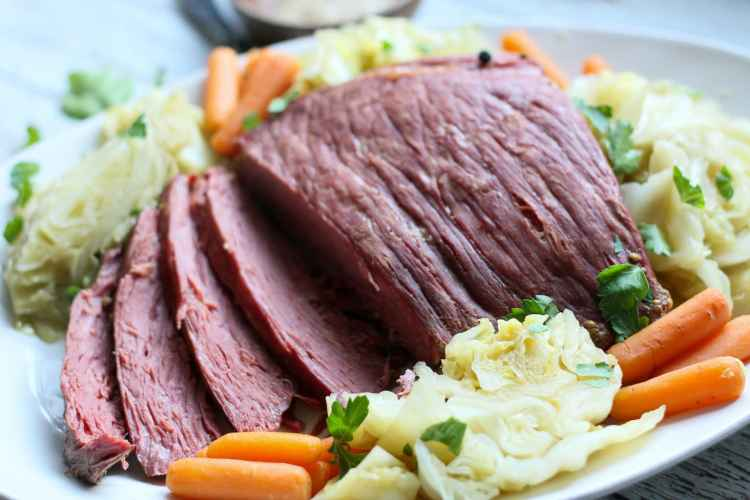 sliced low carb instant pot corned beef and cabbage with carrots