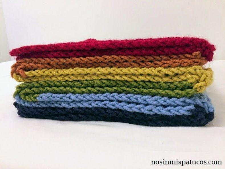 manta tejida a mano en colores arcoiris
