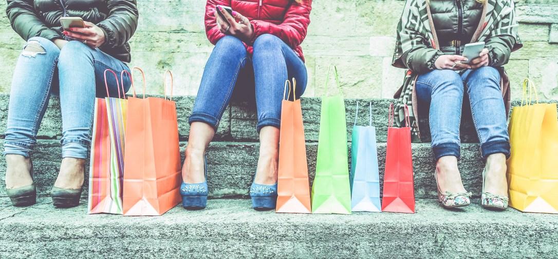Women using smartphone for online shopping