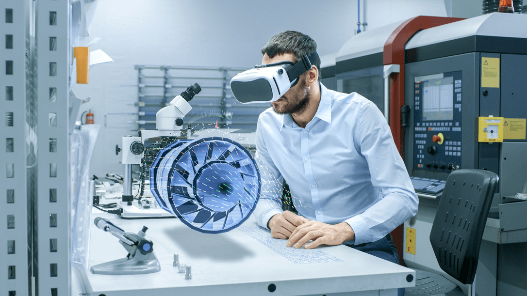 Factory Chief Engineer Wearing VR Headset Designs Engine Turbine on the Holographic Projection Table. Futuristic Design of Virtual Mixed Reality Application