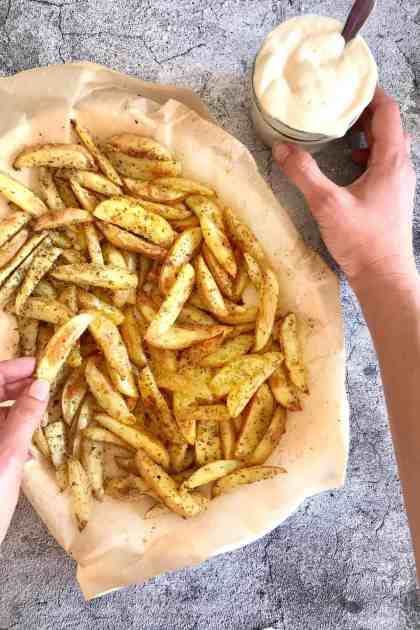 homemade baked French fries with dipping sauce