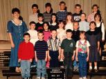 Second grade class photo. I'm second in from the left on the bottom row.