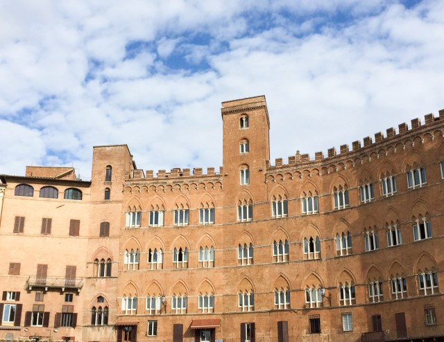 Palazzos line the Piazza del Campo in Siena, Italy