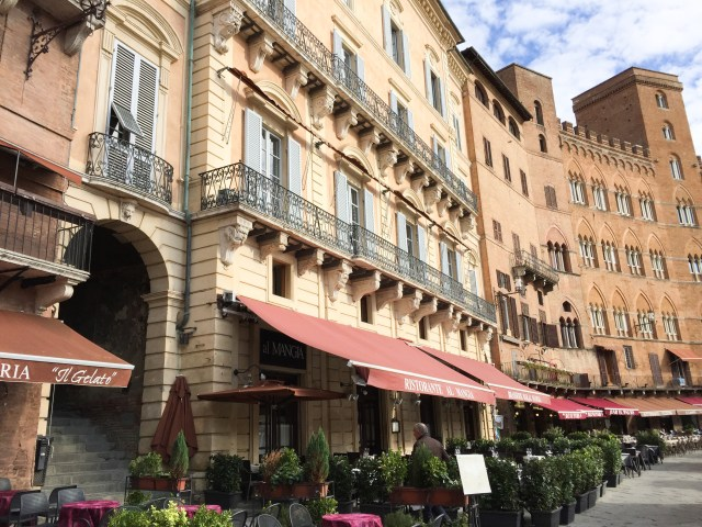 Restaurants and cafes line the Piazza del Campo in Siena Italy