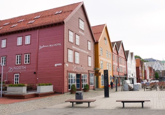 The pretty wooden Bryygen buildings of Bergen, Norway, are a must-see attraction on your one day in Bergen!
