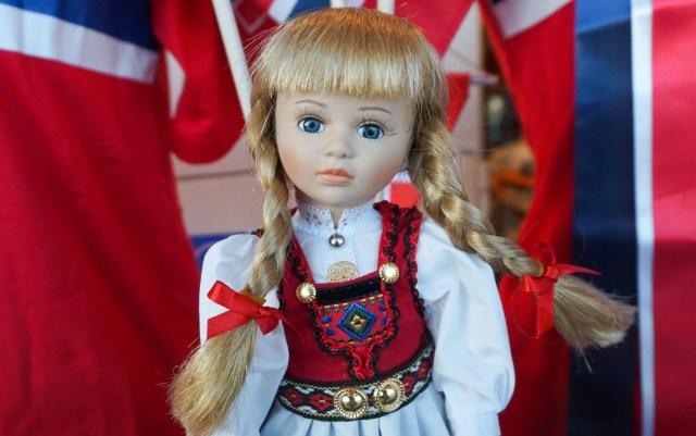 A beautiful Norwegian doll in a storefront in Bryggen Bergen, Norway