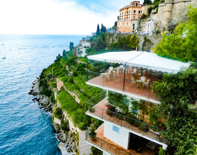 Buildings cling to the cliff on the Amalfi Coast of Italy