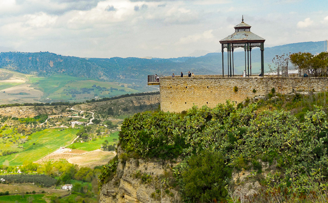 Taking in the views from the mirador at the Alameda del Tajo is one of the top things to do in Ronda, Spain!