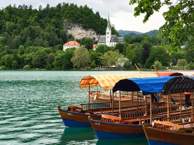 Pletna Boats docked right below Hotel Park in Lake Bled Slovenia