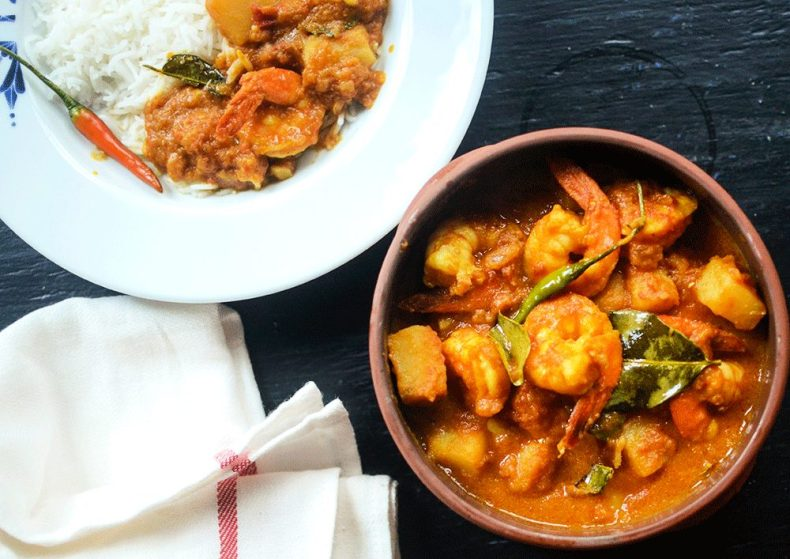 Godhoraj lebu die chingri macher torkari or Bengali style prawn curry with lime leaves.