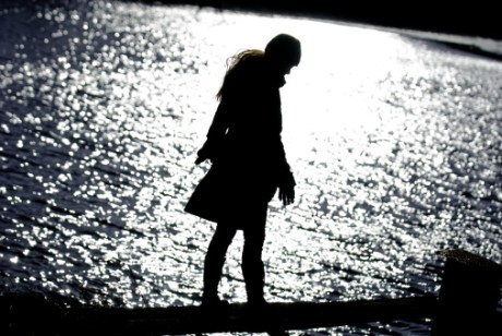 145158376-female-shadow-by-water-1.1