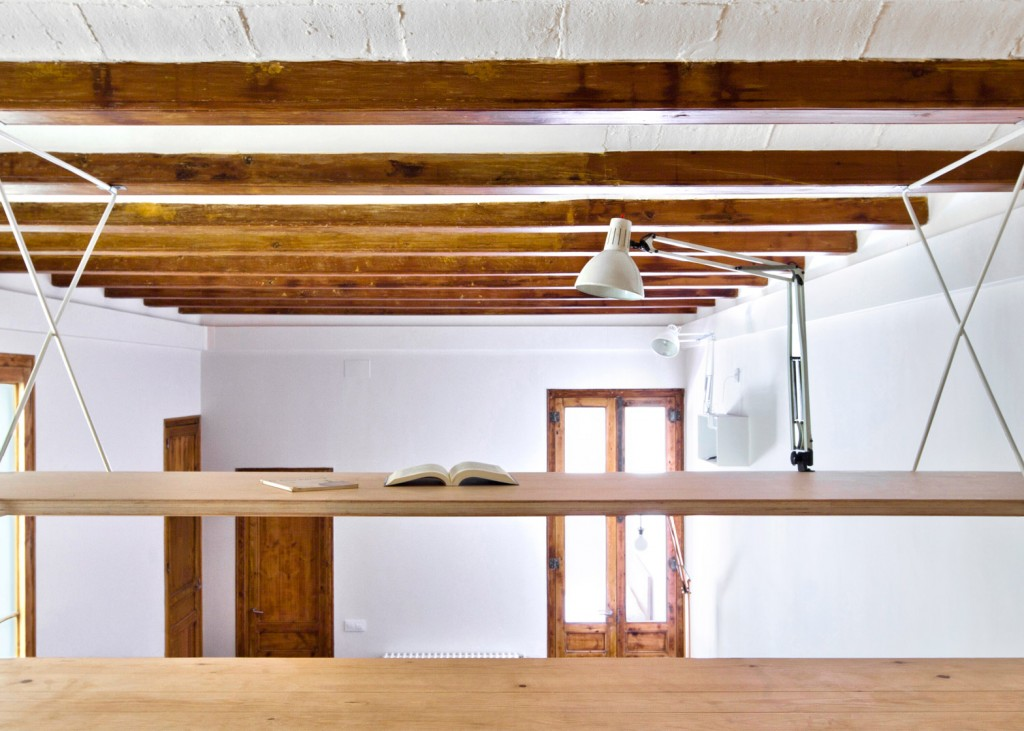 Wooden Desk is Hanging From the Ceiling in this Apartment