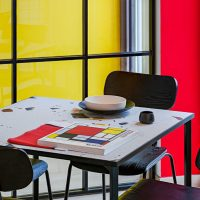 Bauhaus and Piet Mondrian inspired restaurant interior in Vilnius