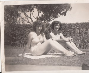 Patricia 19 far distance with a friend, in bikinis in 1950s