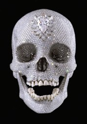 for-the-love-of-god-sculpture-by-damien-hirst-platinum-cast-of-a-human-skull-covered-with-8601-diamonds