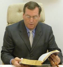 Pastor Gale Miller study the Word