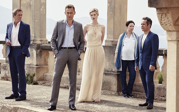 Tom Hiddleston as Jonathan Pine, Tom Hollander as Major Corkoran, Elizabeth Debicki as Jed Marshall, Olivia Colman as Angela Burr, and Hugh Laurie as Richard Roper - The Night Manager _ Season 1, Gallery - Photo Credit: Mitch Jenkins/The Ink Factory/AMC Itís the first TV adaptation of a le CarrÈ novel in more than 20 years and the first adaptation of The Night Manager. The novel, originally released in 1993, has been updated as an contemporary interpretation ñ the original novel is based predominantly in South America and Mexico - and sees Roper selling weapons to the Colombian drug cartels. The story has been updated so that it is set in the modern day Middle East ñ it is very current with the first episode opening with the Arab Spring in Cairo. Olivia Colmanís character, Angela Burr, was written as a man in the novel (Leonard Burr) but the decision was made to make the character female to modernise the story. Olivia was also pregnant when she got the part, so they incorporated this into the story too. Susanne Bier (director): ìWe had decided that Burr should be played by a woman, rather than a man as in the book, because we thought there was an exciting chemistry between a woman and a man engaging in the power struggle that Roper and Burr have.î Hugh Laurie has been trying to get the adaptation made for many years, having read the novel when he was young ñ he tried to get the rights but they were owned by Sydney Pollock who originally tried to make the novel into a film. Hugh Laurie (plays Roper): ìI fell in love with this book when I first read it back in 1993. Iíd worshipped le CarrÈ since I was a teenager, but this story, in particular, I found endlessly intriguing, powerful and romantic, mythic almost.î