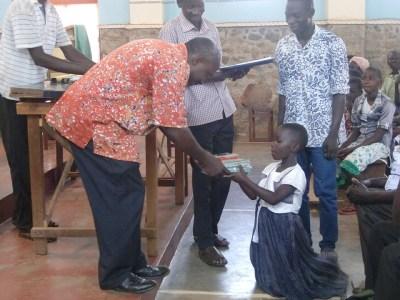 Orphans receiving school supplies