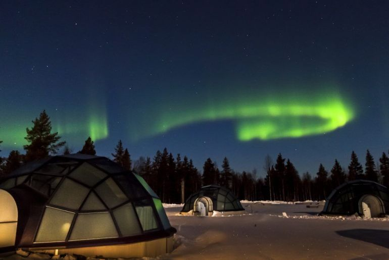 glass igloos and northern lights