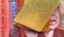 Onces d'or disposées sur un billet de 50$ canadien. Photo: Thinkstock.com