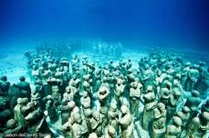 """Underwater sculpture, in Grenada, in honor of our African Ancestors who were thrown overboard the slave ships during the Middle Passage of the African Holocaust."""