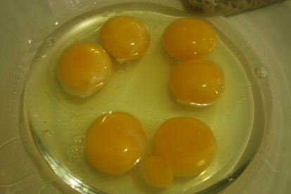 WEIRDEST THING EVER: I cracked THREE eggs pulled at random out of the carton, and this is what came out of them. What are the odds?