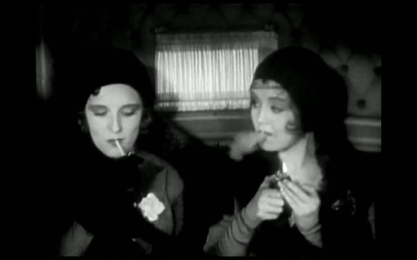 Two jazz babies smoking and being modern; the older-looking one on the left is the step-daughter.