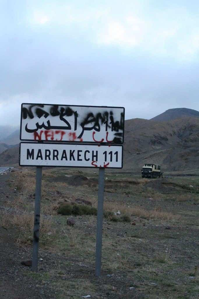 Sign Marrakech 111km during African Trails Atlas Mountain bush camp, Morocco (2011-10)
