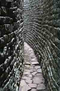 Grey, narrow walls at Great Zimbabwe ruins (2012-03-31)