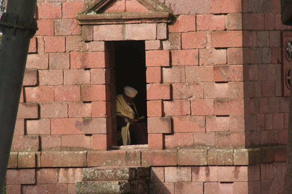 Man reading in a church, Lalibela, Ethiopia (2012-06)