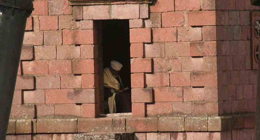Man reading in a church, Lalibela, Ethiopia (2012-06)