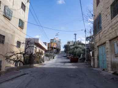 Walking up towards the Jewish settlement in the oldest part of town on Tel-Rumeida, Hebron, Palestine (2017-01-08)