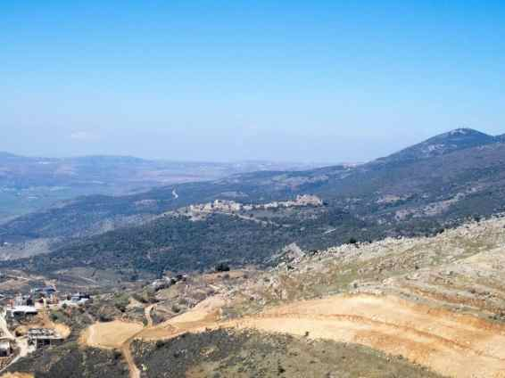 View towards Nimrod Fortress with Druze town Ein Kinya in the foreground, Golan Heights, Israel (2017-01-30)