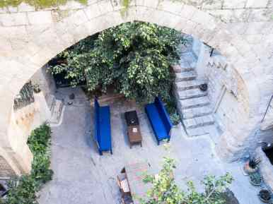 Looking into the courtyard of the Fauzi Azar Inn, Nazareth, Israel (2017-02-03)