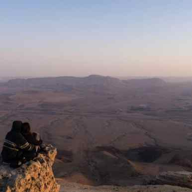 Couple at sunset on Camel Rock, Ramon Crater, Mitspe Ramon, Israel (2017-02-08)