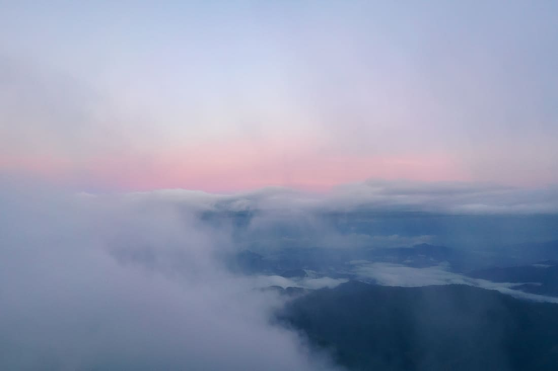Break in the clouds during sunrise on top of Mt. Ramelau, East Timor