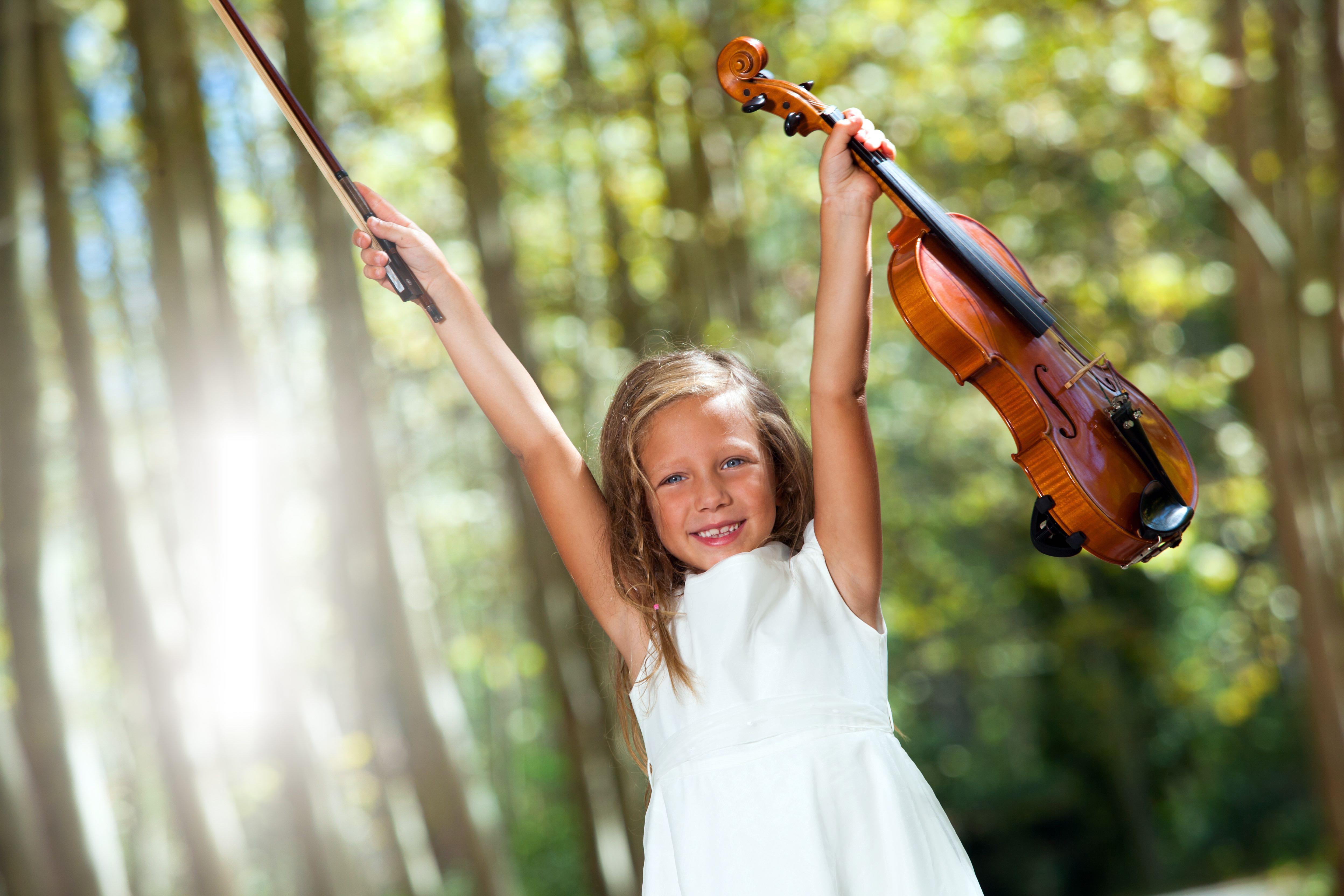 bigstock-Happy-Violinist-Raising-Violin-39724339-copy