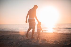 Stefather and child at beach