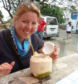 Eva drinking a coconut