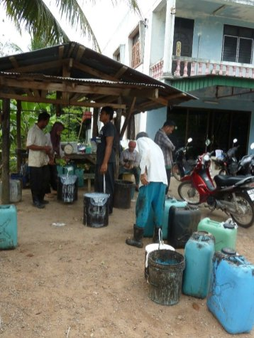 Liquid rubber being sold from a local plantation