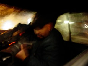 Omar in the backseat of the cab