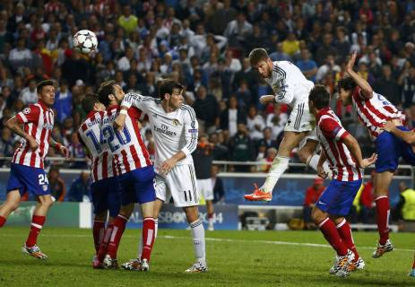 Real Madrid's Ramos rises above the Atletico Madrid defence to score a goal during their Champions League final soccer match at the Luz Stadium in Lisbon