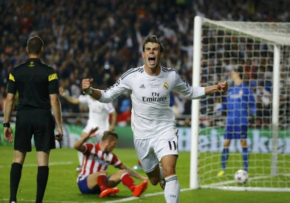Real Madrid's Bale celebrates after he scored a goal against Atletico Madrid during their Champions League final soccer match at Luz stadium in Lisbon
