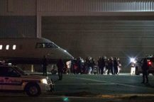 """Authorities escort Joaquin """"El Chapo"""" Guzman from a plane to a waiting caravan of SUVs at Long Island MacArthur Airport, Thursday, Jan. 19, 2017, in Ronkonkoma, N.Y. Guzman was extradited to the U.S. to face drug trafficking and other charges. (AP Photo/Kevin Hagen)"""