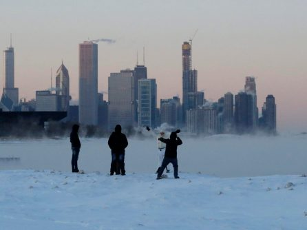 People enjoy at the Lake Michigan at 31st Street Harbor, Wednesday, Jan. 30, 2019, in Chicago. A deadly arctic deep freeze enveloped the Midwest with record-breaking temperatures on Wednesday, triggering widespread closures of schools and businesses, and prompting the U.S. Postal Service to take the rare step of suspending mail delivery to a wide swath of the region. (AP Photo/Nam Y. Huh)
