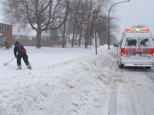 Emergency crews responding to a medical call shovel a path to the woman's apartment, Wednesday, Jan. 30, 2019 in Lackawanna, New York. The area was under a blizzard warning and officials urged people to stay inside and out of wind-driven snow and sub-zero wind chills. (AP Photo/Carolyn Thompson)