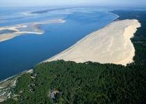 da14eb3df594a0af12ccb36268f17021 - Montaña de arena se traga bosque, casas y carreteras