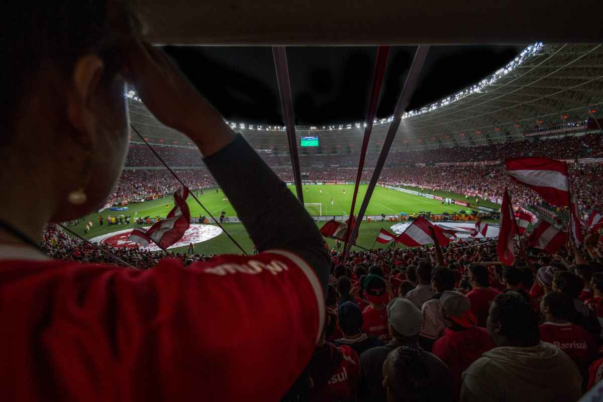 group of people watching soccer game