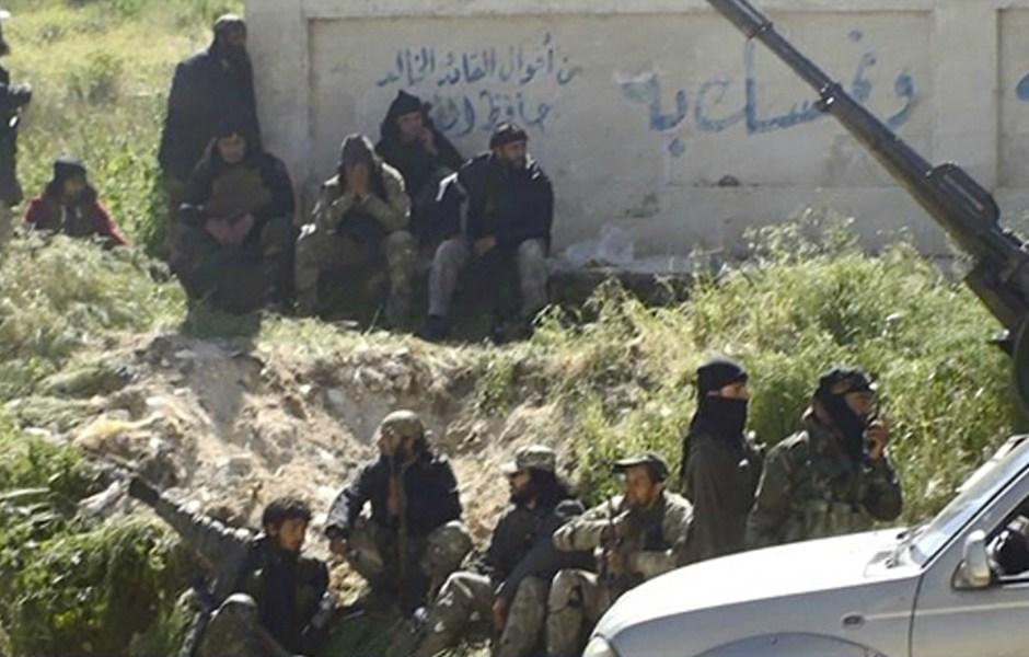 Fotografía que muestra a un grupo de rebeldes sirios que tratan de derrocar al presidente Bashar Assad. (AP/archivo)